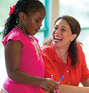adult volunteer with girl