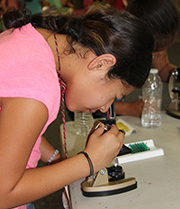 Girl Scout and microscope