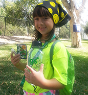girl with camp kit