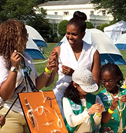 Michelle Obama knot tying with Girl Scouts